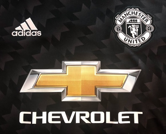 Man Utd away kit sponsor logo